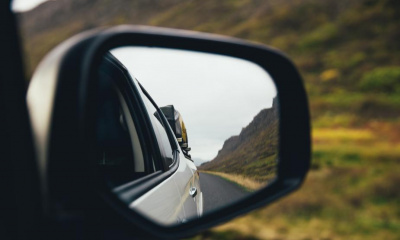 rear-view-mirror-on-highway