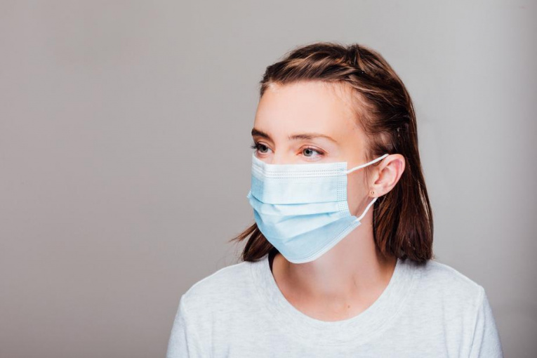 portrait-of-a-woman-wearing-disposable-face-mask