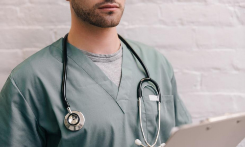 male-doctor-with-stethoscope-and-clipboard