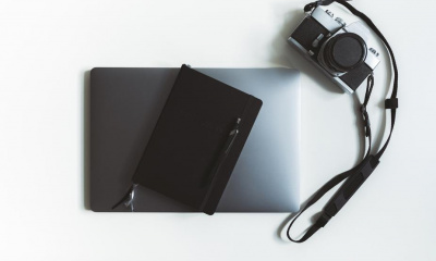 flatlay-of-a-laptop-and-camera-with-stationary